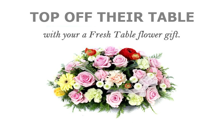 TOP OFF THEIR TABLE with your a fresh flower gift.